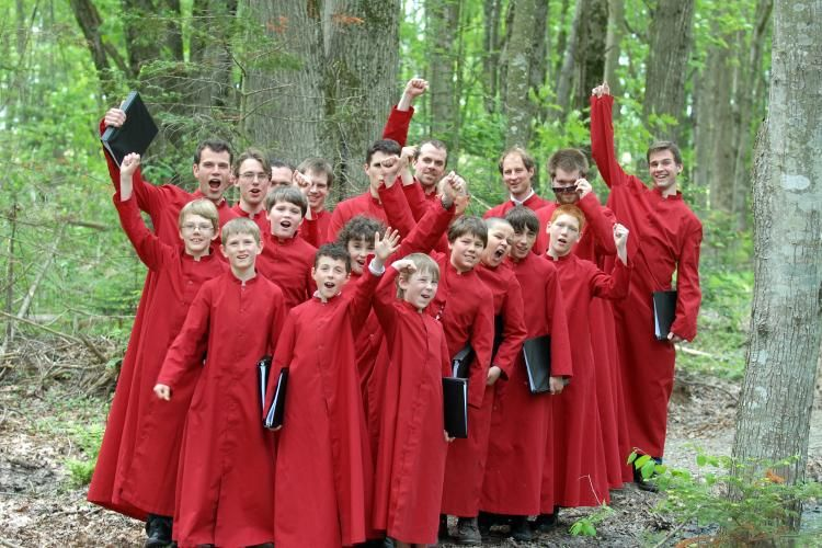 Group shot in the woods with red robes.