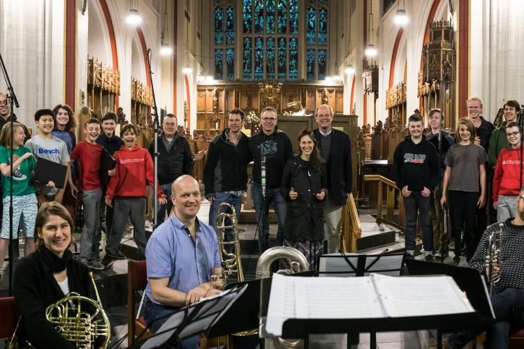 Group photo of men and boys, directors, and Maritime Brass at end of recording session