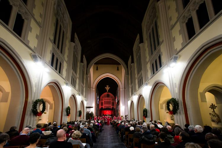 Photo of large audience at Christmas concert in Cathedral with choir far up at front