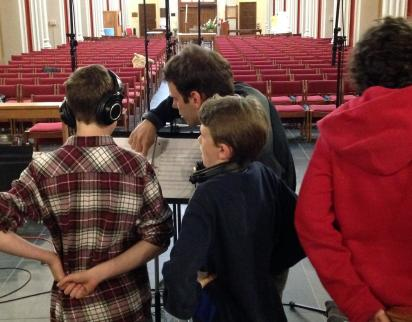 Director Nick Halley works with the boys during a recording session (2014).