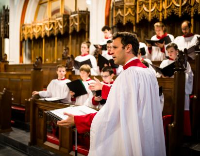 Founder and Director Nick Halley leading the choir in an Evensong, 2017.