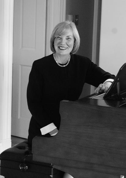 Barbara Butler sitting at the piano